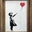 Una obra de Banksy se autodestruye tras ser subastada por un millón de libras (video)